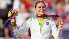 Final Gold Medal: Gold medallist Laura Asadauskaite of Lithuania celebrates during the Victory Ceremony for the Women's Modern Pentathlon on Day 16