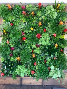 A tropical wall of greenery with pops of color! Perfect use for a picture wall, or just to spice up your event!