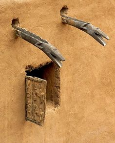 Dogon window and water spouts.