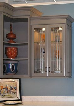 In the Kitchen Views showroom in Mansfield, MA you can see how open corner shelves can display large pottery and a cabinet with glass doors can display glassware.
