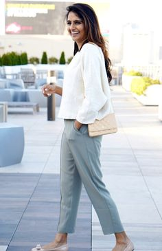 woman wearing white sweater and green pants for tech casual look on Who Wore What | Skirt The Ceiling | skirttheceiling.com