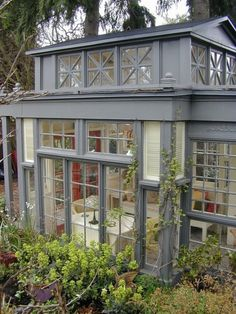 Conservatory, 43 recycled glass windows and doors; Randolph Scott Keller & Jennie Hammill; via ShedStyle. ***This is 10x14 feet (= 3 x 4,20 meters) or 140 square feet (= 12,6 m²), which is not tiny or 'miniature' or 'diminutive' at all for a tea house/ garden shed/ glass house, as stated in so many other pins.