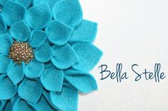 bright blue felt flower for hair, accessorizing a hat or wearing as a pin