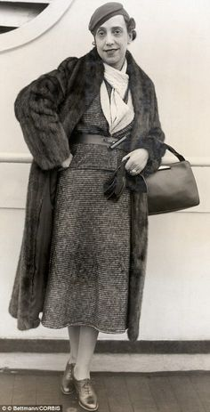 Elsa Schiparelli in a suit of her own design . . . I like the tweed, the belt over the jacket . . . I'm skipping the fur coat.  It is summer after all.