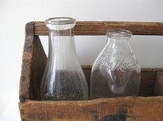 milk bottles in old tote