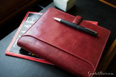 The Lockwood Organizer is the professional's perfect accessory. Offered in rich Garnet and cool Aqua, the Lockwood is made of buffalo leather which is polished smooth for a graceful look. Pair it with a Lamy 2000!