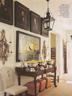 P Allen Smith via Acanthus and Acorn  love the use of ottomans with a console table...even though no one will ever use them!