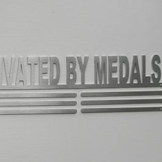Ridiculously Motivated by Medals.  Stainless Steel Medal Hanger.  SA Medal Hangers - Premier Medal Hanger designers | Hello Pretty. Buy design.