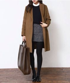Coat in black/grey Skirts,tights and black boots Turtle necks Silky camisoles/long sleeves