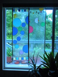 Frank Lloyd Wright, from Great American Artists for Kids.  Bubble Window.  American Artists for Kids book came through with a project using simple materials we had on hand.    Clear contact paper  Colored art tissue (Thanks to a stash from my daughter Amanda at Hearts and Trees!)  Black Sharpie marker and/or black electrical tape  Ruler or yardstick  Scissors  Circle templates (jar lids or cups worked well for us)…