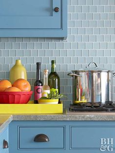 Blue Kitchen With Bright Accents And Glass Tile Backsplash By Elizabeth  Swartz Interiors