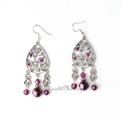 Chandelier long dangling earrings in plum (dark pink purple) in silver-plate, glass, and Swarovski crystals. Handmade by MoonlitMemory on Etsy.