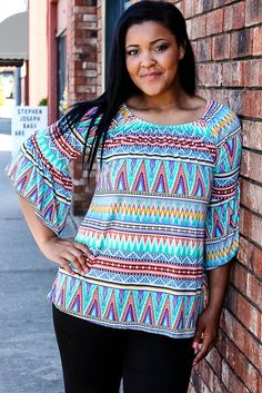 Printed stretch top with a loose fit and bell sleeves. Destanee is wearing a size Large.