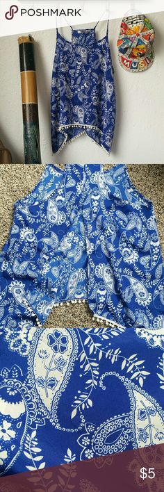 Split Back Tank Perfectly open and flowy blue and white paisley racerback tank top with thin straps. Second picture shows the open slit in the back of the tank. Adorable little white pom poms along the hem. Like new with no damage. Love Blossom  Tops Tank Tops