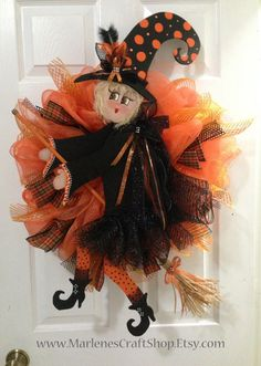 Welcome Halloween with this fancy witch all decked out with traditional Halloween colors of orange and black. From her handmade broom to her big brown eyes she is very detailed and would look fantastic on any door or wall! This is a ready made item. The one in the picture is the one I will ship! Thanks for looking and Happy Halloween