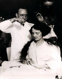 "Hotel McAlpin, barber shop, 1920s - a woman trades her long locks for a fashionable bobbed cut. Women went to barbers as they could cut hair better than beauticians, it wasn't until after the ""Bob Haircut"" that beauty shops or salon started to learn to cut styles! Before they gave perms, curled, henna color, or styled hair only."