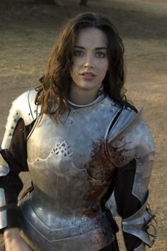 [ A photograph of a pale skinned blue eyed woman from the waist up. She wears the torso and arm armour of a Conquisitidor, her long brown hair spilling acros her shoulders, red blood splattered across the left side. She regards the viewer with a look of concentration. ]  womenfighters:    Another picture of Nicole Leigh from Jetrefilm's Shroud.    Wow, that film looks all sort of awesome.