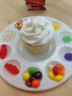 Great party idea! Get paint trays from the dollar store and have kids design their own cupcake. Fun, engaging and wilk keep them busy for a little while!