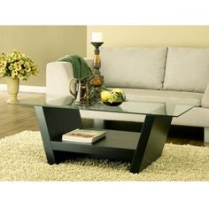 Arched leveled coffee table features a glass top  Modernize your home decor with this accent table  Furniture has two arched leveled side corners enforced by a stylish middle center console