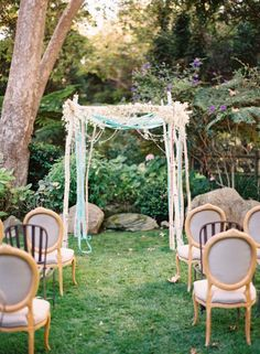 Vintage Storybook Wedding in Montecito, California. Archive Rentals Birch Arbor with ribbons and crystals. Mixed Ceremony Seating by Archive Rentals. Florals by Nico Cervantes, NLC Productions. Photo by Kurt Boomer