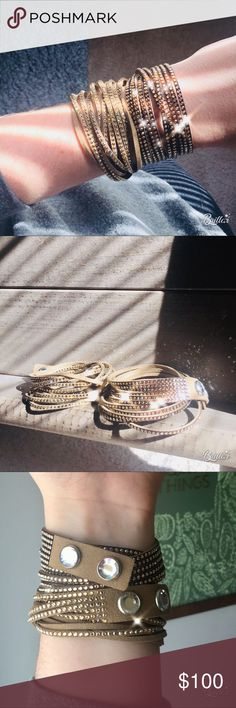 Swarovski Slake Silk Wrap Bracelet Two perfect condition Swarovski Slake Silk Bracelets. One is a suede tan color and one is a darker brown leather.   Retail for one is $69.  Pet and smoke free home.  Check my page for single bracelets. Swarovski Jewelry Bracelets
