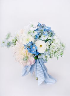 Blue and white bouquet tied with seersucker ribbon