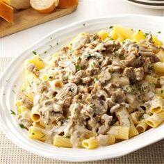 Creamy Sausage-Mushroom Rigatoni - 16 oz rigatoni, 1 lb sausage, 2 t butter, 1 lb sliced fresh mushrooms, 2 garlic cloves minced, 1/2 t salt, 1/4 t pepper, 2 c heavy whipping cream, fresh parsley.