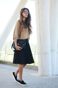 a line skirt and slip on sneakers