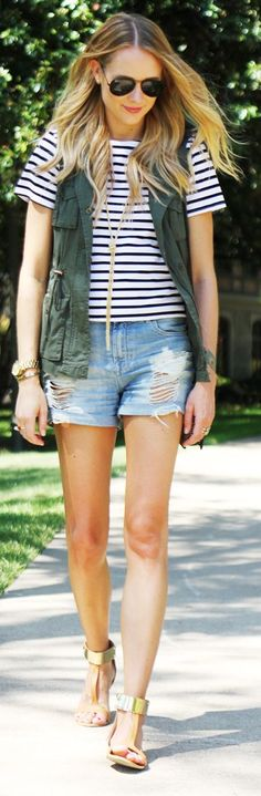 Navy striped shirt, ripped denim shorts, army jacket, and gold cuff sandals.