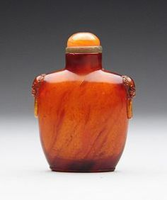 A Fine Amber Snuff Bottle with Mask Handles