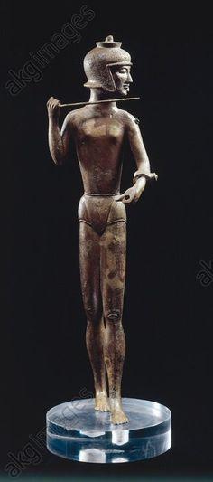 STATUETTE OF A WARRIOR / ETRUSCAN. Etruscan, Archaic, c. 550 BC.  Statuette of a warrior.  Bronze, height 36.2cm. Found in: Brolio, Montecchio Manor, Votive depot. Inv. No. 562