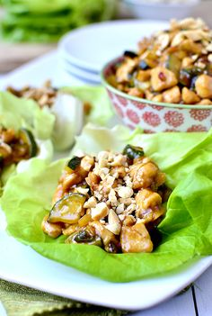 Kung Pao Chicken Lettuce Wraps taste like they came straight out of a restaurant. My favorite take out fake out dish to date! | iowagirleats.com