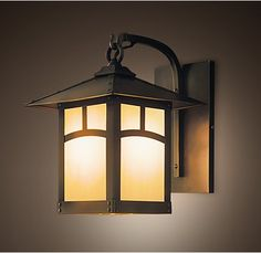 We like this sconce for the front door, but are also happy to use what you used at the Knoll House in Bath.