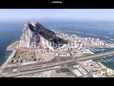 Gibraltar: Little tiny city attached to Spain, owned by the UK, and with a view to Africa. Coming from Spain, I had to cross that runway on foot. This place has primates) Rock Of Gibraltar, Malaga, Places To Travel, Places To See, British Overseas Territories, Spain And Portugal, Aerial View, The Good Place, Andalusia
