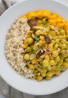 Peanut-Ginger Curry Chickpeas over Fluffy Brown Rice. Cut down maple syrup and omitted dates