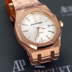 #AudemarsPiguet #RoyalOak 41mm #Watch in 18kt #RoseGold. (factory protective stickers visible in image). #Audemars Piguet model number 15400or.oo.1220or.02 MSRP $50,500 visit www.prestigetime.com for pricing.  Featuring: the #AP signature Grande Tapisserie dial in silver. Screw-in crown, water resistant to 50 meters. Transparent case back. Silver dial. Case & bracelet is brushed finished with polished finished beveled corners.