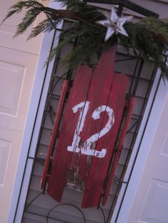 Holiday Curb Appeal - old sled, paint house # on it