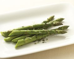 Try this easy to prepare herbed butter recipe on asparagus for a delicious, healthy side to add to any meal! #healthychoices #fresh #easy