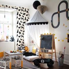 kids' reading nook with canopy, use crib mattress, throw pillows, and wall shelves