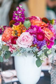 Seeing lots of colorful weddings on #SMP this week!! See this one here: http://www.StyleMePretty.com/mid-atlantic-weddings/2014/04/11/rustic-meets-preppy-north-carolina-wedding-at-claxton-farm/ StephanieYoncePhotography.com || Centerpiece: Bloom-Room.com