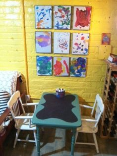 kids chalk board table and art gallery wall