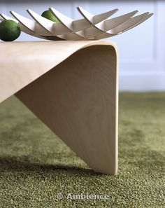 Close-up of modern bowl on moulded plywood table