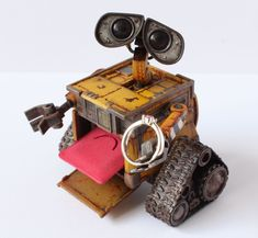 Here is another version of popular engagement ring box inspired by Wall-E from Disney Pixar animated movie. This time it was not made from scratch but it is customized toy so it have more articulation. The pillow slide on custom made mechanism, all is repainted to look like character in the movie. #walle #engagement #ringbox #custom #toy #wall-e #disney #pixar Pixar Animated Movies, Popular Engagement Rings, Ring Boxes, Wall E, Disney Pixar, Toy, Inspired, Character, Clearance Toys