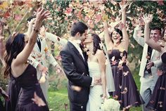 perfect autumn wedding - throwing leaves in the air as the bride and groom exit for the evening