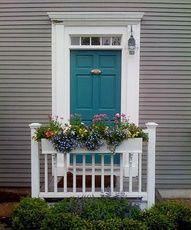 grey house black shutters blue door - Google Search