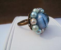 https://www.etsy.com/listing/150587762/vintage-blue-ring-adjustable?ref=shop_home_active