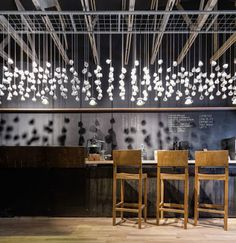 I'm loving this. Some of the coffee cups are pendant lights. We could make a version somewhere but want to be careful not to be to cliché?