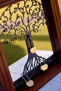 """The Tree of Life is a unique way to """"lock your love"""" at a wedding ceremony. Each love lock can have a personal message engraved and guests are welcome to add locks also. - See more at: http://www.easyweddings.com.au/real-weddings/danielle-tarrant-close-the-gap-at-their-elegant-vintage-wedding/#sthash.R02w0Yoj.dpuf"""
