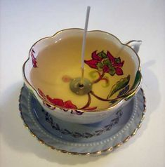 how to make tea cup candles - another site also said this : use a bit of melted wax to anchor the metal part to the bottom of the cup before pouring to make sure it stays in place