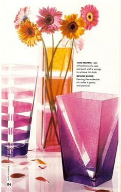 Add interest to a plain vase by using painter's tape to create your design, then  sponging on some colored glass paint.